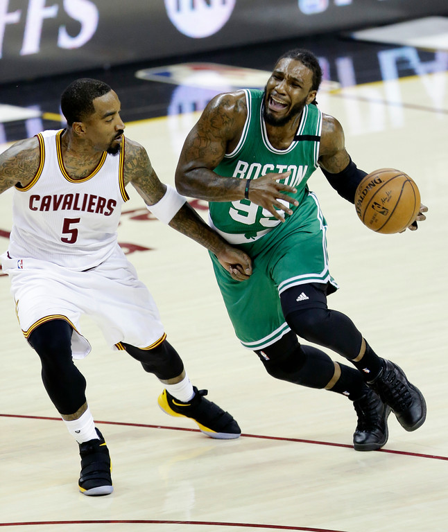 . Boston Celtics\' Jae Crowder (99) drives on Cleveland Cavaliers\' J.R. Smith (5) during the first half of Game 4 of the NBA basketball Eastern Conference finals, Tuesday, May 23, 2017, in Cleveland. (AP Photo/Tony Dejak)