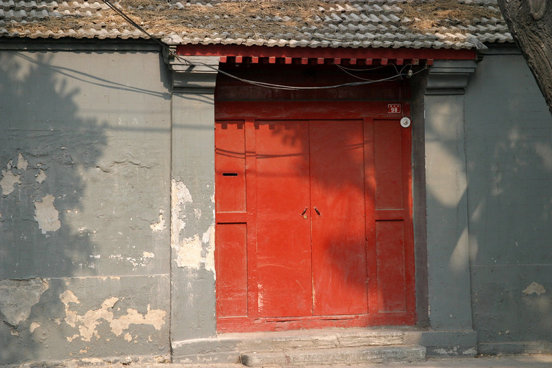 Beijing, an old courtyard home entrance, The old Hutong are disappearing June 2004