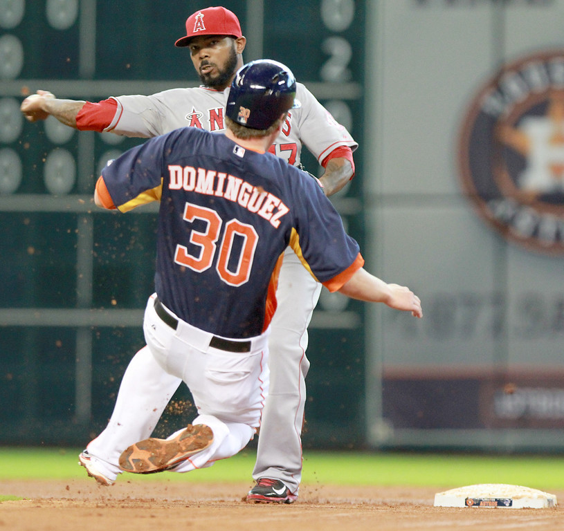 . HOUSTON, TX- SEPTEMBER 15: Howie Kendrick #47 of the Los Angeles Angels of Anaheim turns a double play on Matt Dominguez #30 of the Houston Astros in the fourth inning on September 15, 2013 at Minute Maid Park in Houston, Texas. (Photo by Thomas B. Shea/Getty Images)