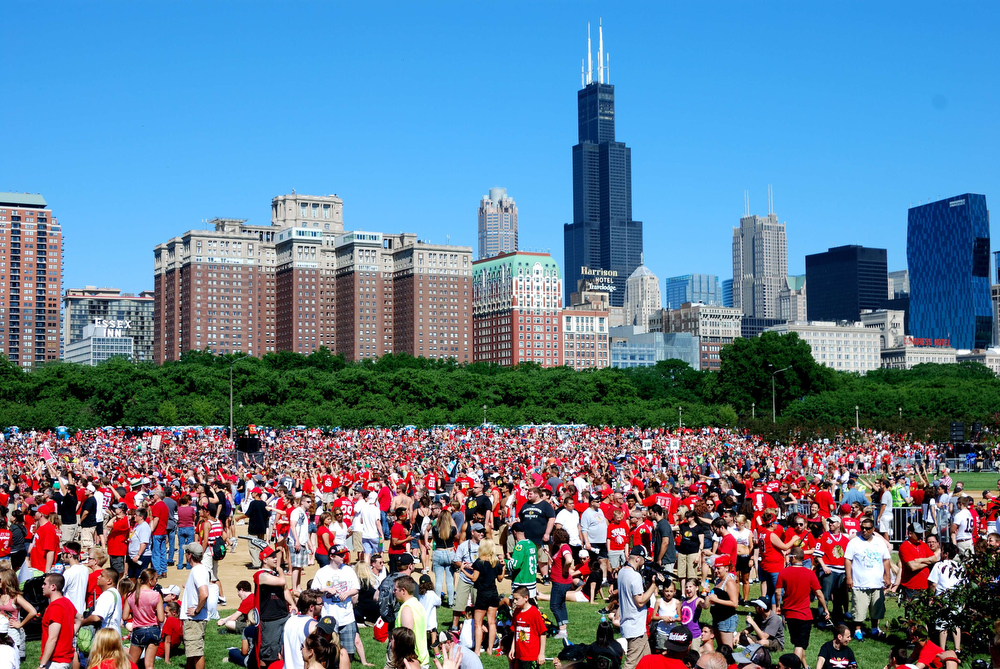 . Thousands of fans await the arrival of the Blackhawks at a rally in Chicago on Friday June 28, 2013 to celebrate the Stanley Cup Champions.  The Blackhawks won the National Hockey League\'s Stanley Cup on June 24, 2013, defeating the Boston Bruins 3-2.      MIRA OBERMAN/AFP/Getty Images