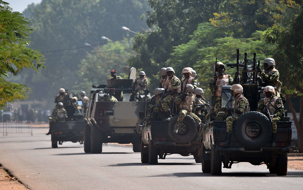 . Burkina Faso troops ride on October 30, 2014 in Ouagadougou. ISSOUF SANOGO/AFP/Getty Images