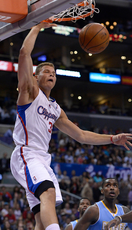 . Clippers#32 Blake Griffin dunks in the first half. The Los Angeles Clippers took on the Denver Nuggets in a regular season NBA game. Los Angeles, CA. 4/15/2014(Photo by John McCoy / Los Angeles Daily News)