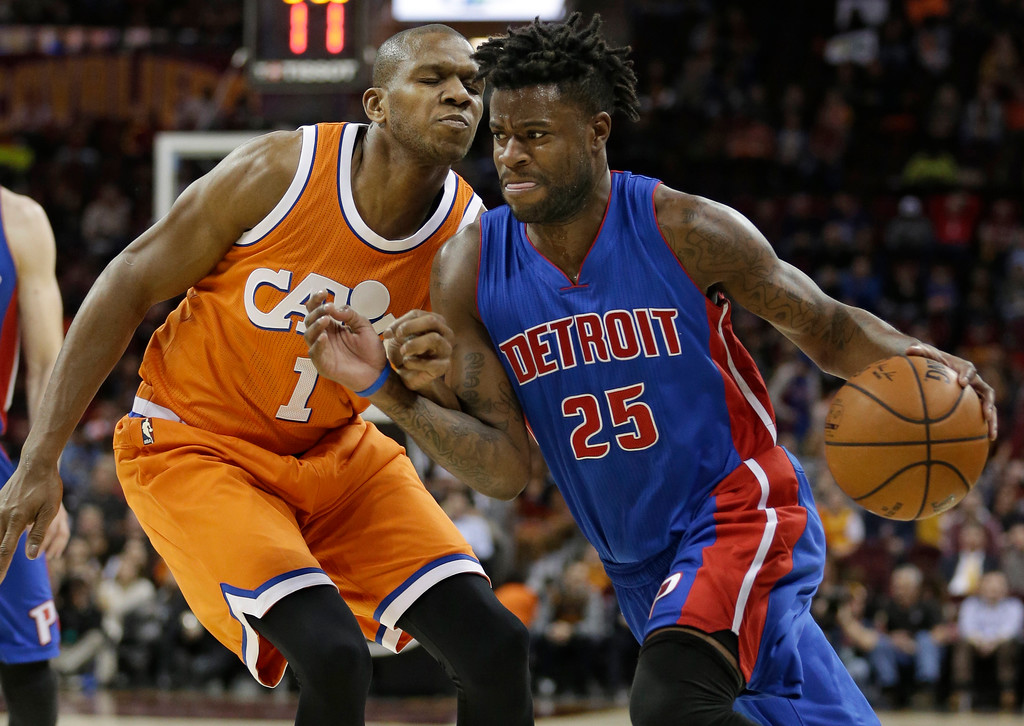 . Detroit Pistons\' Reggie Bullock (25) drives against Cleveland Cavaliers\' James Jones (1) in the second half of an NBA basketball game, Tuesday, March 14, 2017, in Cleveland. The Cavaliers won 128-96. (AP Photo/Tony Dejak)
