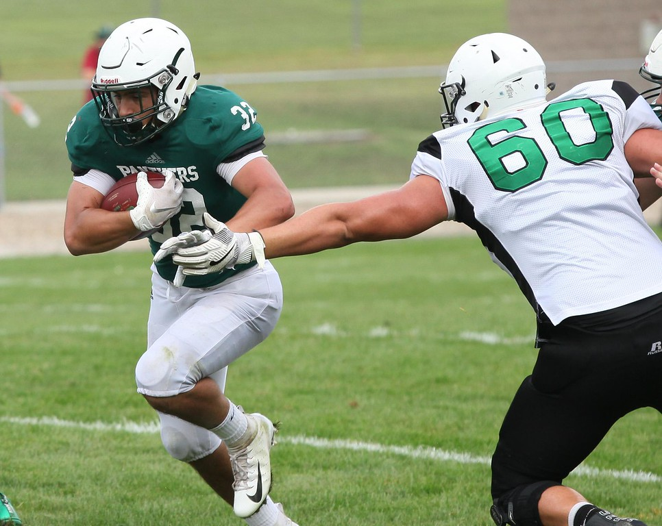 . Randy Meyers - The Morning Journal Elyria Catholic\'s Leighton Banjoff runs for a gain against the Columbia defense during a scrimmage.