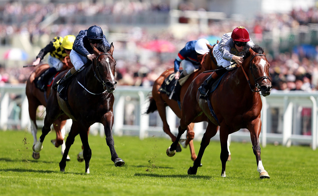 . Toronado ridden by Richard Hughes, right, race to victory in Queen Anne Stakes during Day One of   Royal Ascot horse racing meeting at Ascot England Tuesday June 17, 2014. (AP Photo/David Davies/PA)