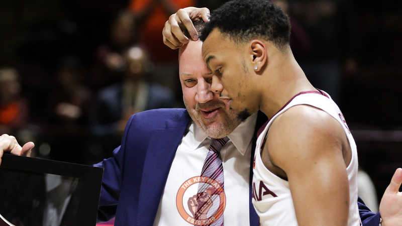 Justin Robinson hugs head coach Buzz Williams during senior day ceremonies before the game. (Mark Umansky/TheKeyPlay.com)
