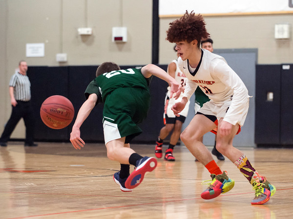 02/07/20 Wesley Bunnell | StaffrrGoodwin Tech boys basketball defeated Cheney Tech at home on Friday February 7, 2020. Josaiah Santiago (11) with a steal.