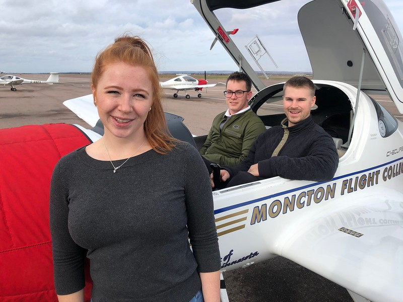 Three Life in Flight students with an MFC Diamond DA-20 training aircraft: Kristi-Lee Bauchke, Troy Wilson and Kirk Sparkes. EIC Photo