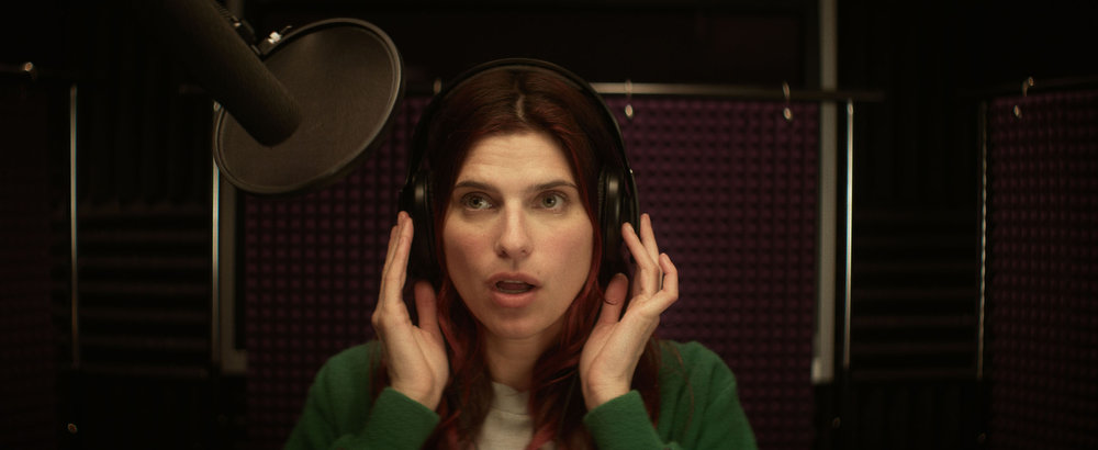 Description of . IN A WORLD...: (U.S. Dramatic) A whole lot of comic talent — including Rob Corddry, Ken Marino and Michaela Watkins — is assisting actress and first-time writer-director Lake Bell on her story of a vocal coach trying to make it as a voice actor.