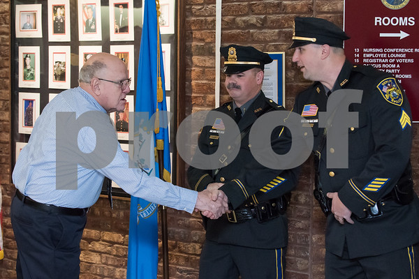 01/17/18 Wesley Bunnell | Staff The Berlin Police Department held a promotion ceremony for two officers on Wednesday evening at town hall. Police Commissioner Chairman Bob Peters shakes hands with new promoted Sergeant Ryan Gould as Lieutenant Drew Gallupe looks on.