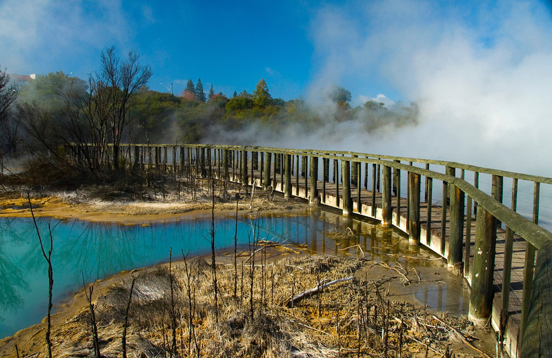 Steam rises from colourful thermal lakes in Rotorua New Zealand