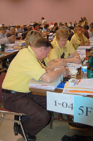 Voting members from northwest Iowa of pray before voting at the 2009 ELCA Churchwide Assembly.