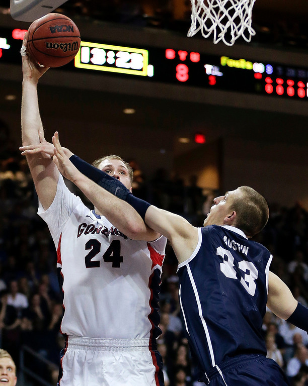 . Gonzaga\'s Przemek Karnowski (24) puts up a shot against BYU\'s Nate Austin (33) in the first half of the NCAA West Coast Conference tournament championship college basketball game, Tuesday, March 11, 2014, in Las Vegas. (AP Photo/Julie Jacobson)