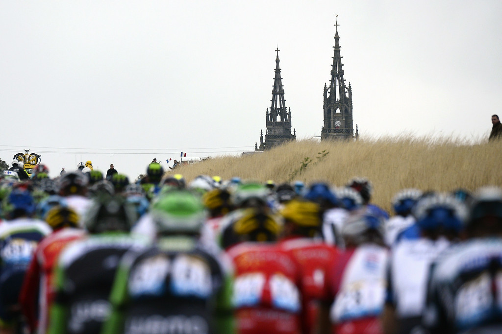 . The pack rides during the 234.5 km seventh stage of the 101st edition of the Tour de France cycling race on July 11, 2014 between Epernay and Nancy, northeastern France.  AFP PHOTO / LIONEL BONAVENTURE/AFP/Getty Images