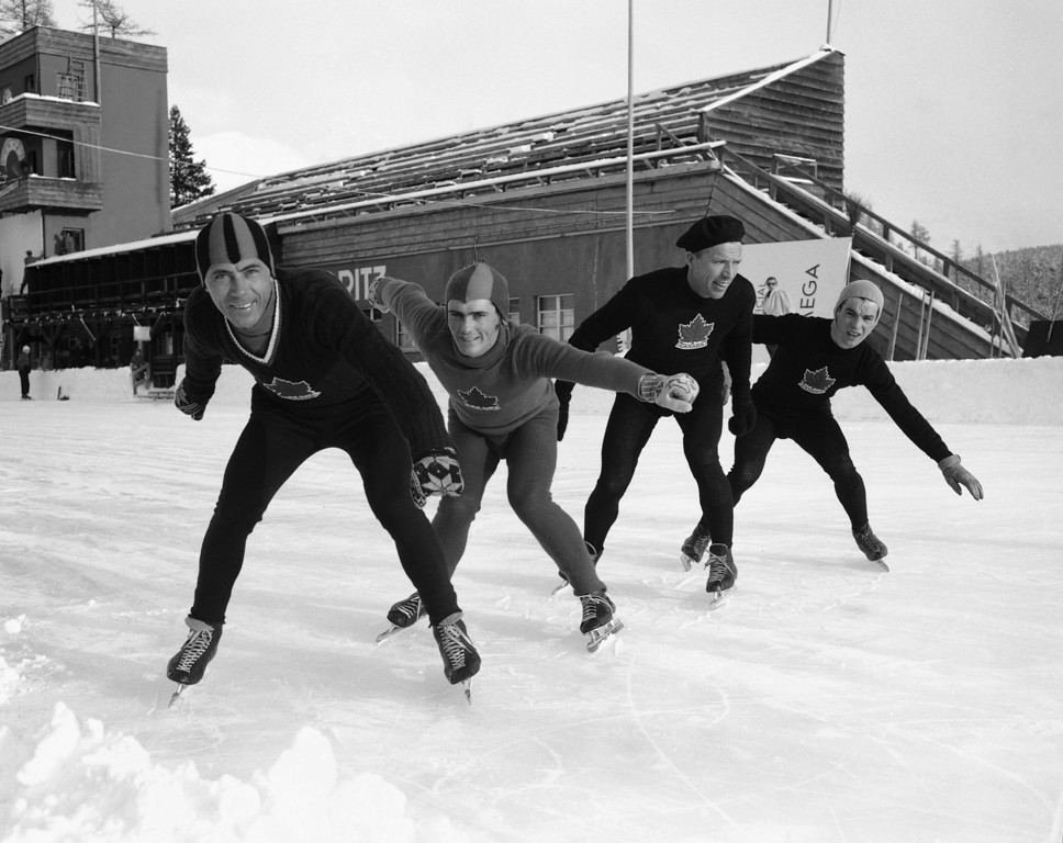 . Frank Stack, of Winnipeg, Canada; Gordon Audley, also from Winnipeg; A.B. Hardy, of Edmonton, and Craig MacKay, left to right, from Saskatoon, members of the Canadian Olympic speed skating team, set to go during a practice at the ice stadium as they prepare for the 1948 Winter Olympics, Jan. 21, 1948, St. Moritz, Switzerland. (AP Photo)