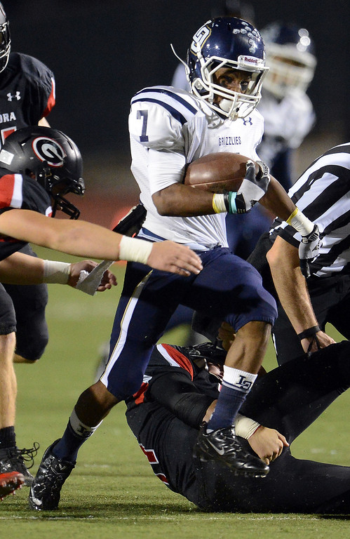 . Los Osos\' Malcolm Smith (7) runs for a first down against Glendora in the first half of a prep football game at Citrus College in Glendora, Calif., on Thursday, Oct. 31, 2013.    (Keith Birmingham Pasadena Star-News)