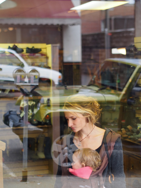 This young mom reluctantly agreed to have her photo taken through the shop window. I'm glad she did.