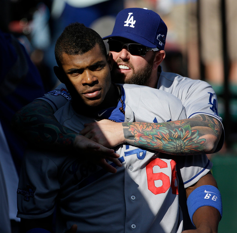 . Los Angeles Dodgers\' Yasiel Puig (66) and Chris Withrow joke around before Game 2 of the National League baseball championship series against the St. Louis Cardinals Saturday, Oct. 12, 2013, in St. Louis. (AP Photo/David J. Phillip)