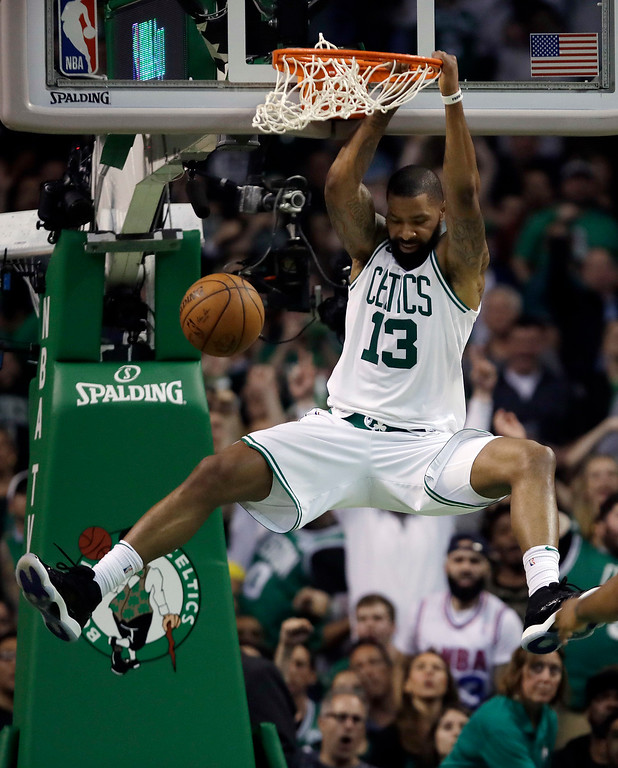 . Boston Celtics forward Marcus Morris hangs on the rim after dunking against the Cleveland Cavaliers during the first half in Game 2 of the NBA basketball Eastern Conference finals, Tuesday, May 15, 2018, in Boston. (AP Photo/Charles Krupa)