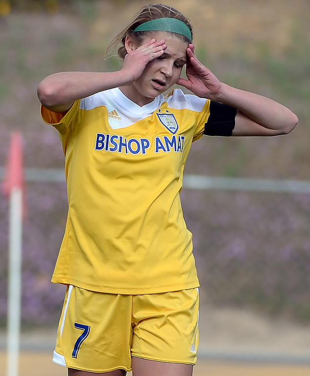 . Bishop Amat\'s Sophia Serafin reacts after missing on a penalty kick against Diamond Bar in the first half of a CIF-SS second round prep playoff soccer match at Diamond Bar High School in Diamond Bar, Calif., on Wednesday, Feb.26, 2014. Diamond Bar won 3-2. (Keith Birmingham Pasadena Star-News)