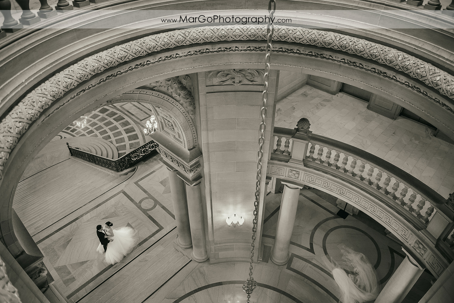 bride and groom in the Rotunda in San Francisco City Hall