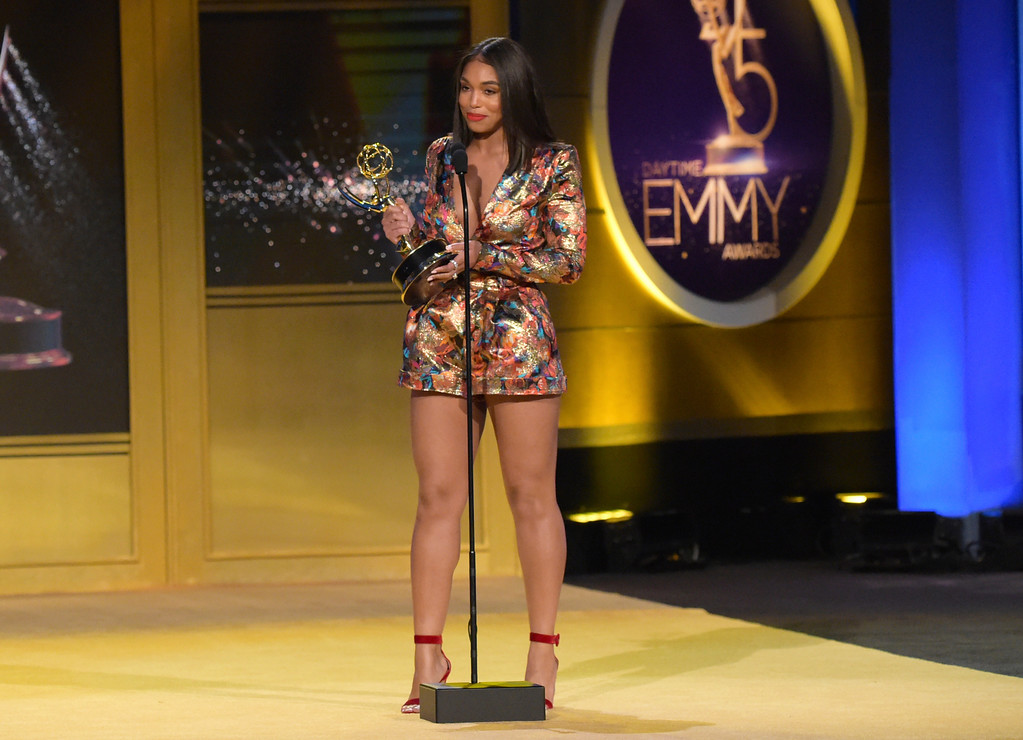 ". Lori Harvey, on behalf of her father Steve Harvey, accepts the award for outstanding informative talk show host for ""Steve\"" at the 45th annual Daytime Emmy Awards at the Pasadena Civic Center on Sunday, April 29, 2018, in Pasadena, Calif. (Photo by Richard Shotwell/Invision/AP)"