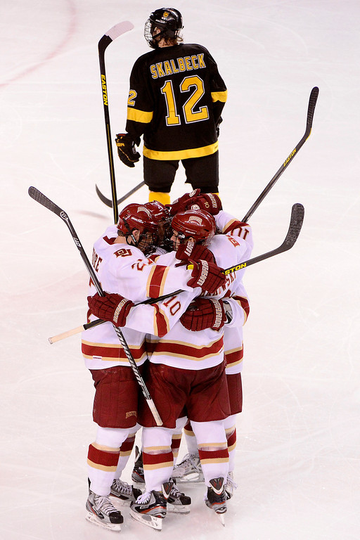 . DENVER, CO - MARCH 17: David Makowski (10) of the University of Denver Pioneers celebrates his game-tying 3-3 goal against the Colorado College Tigers during the third period of action. The University of Denver loses 4-3 to Colorado College during the WCHA playoffs at Magness Arena. (Photo by AAron Ontiveroz/The Denver Post)