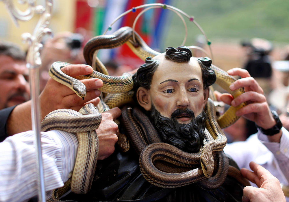 . People cover a wooden statue of Saint Domenico with snakes during a procession in Cocullo, central Italy May 1, 2013. Every year in May, snakes are placed onto the statue of St. Domenico and the statue is then carried in a procession around the town. St. Domenico is believed to be the patron saint for people who have been bitten by snakes.  REUTERS/Alessandro Bianchi