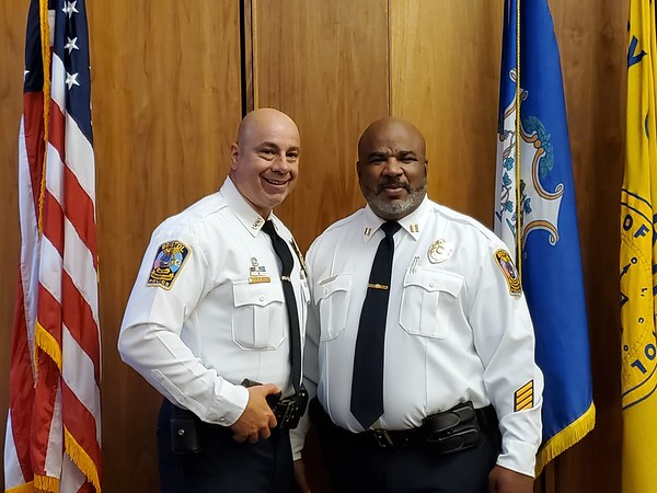 Justin Muszynski | Staff Bristol police Chief Brian Gould, left, with Capt. Stephen Tavares, who was promoted Thursday from the lieutenant rank on Thursday.