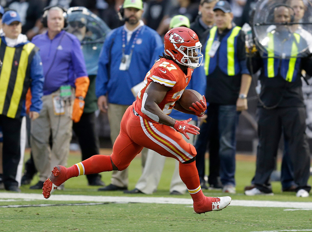 . Kansas City Chiefs running back Kareem Hunt (27) runs against the Oakland Raiders during the first half ofan NFL football game in Oakland, Calif., Thursday, Oct. 19, 2017. (AP Photo/Ben Margot)
