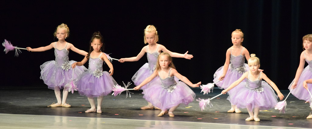 ". Ballerinas dance to ""Cinderella-The Work Song\"" at Melissa\'s School of Dance and Gymnastics\' \""Dance in Motion\"" recital Wedneday, June 13, 2018. Front row, from left; Evangeline Meraz, Laurel Murphy, amd Brinley Hect. Back row, from left; Mya DeMaria, Ameria Hughes, MaKenna Eastin, Lilly Johnson."
