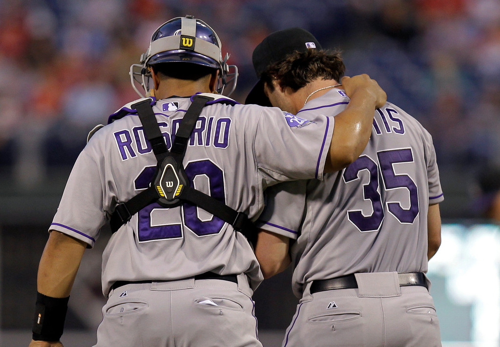 . Colorado Rockies pitcher Chad Bettis talks with catcher Willin Rosario, left, after giving up a run in the second inning of a baseball game against the Philadelphia Phillies, Thursday, Aug. 22, 2013, in Philadelphia. (AP Photo/Laurence Kesterson)