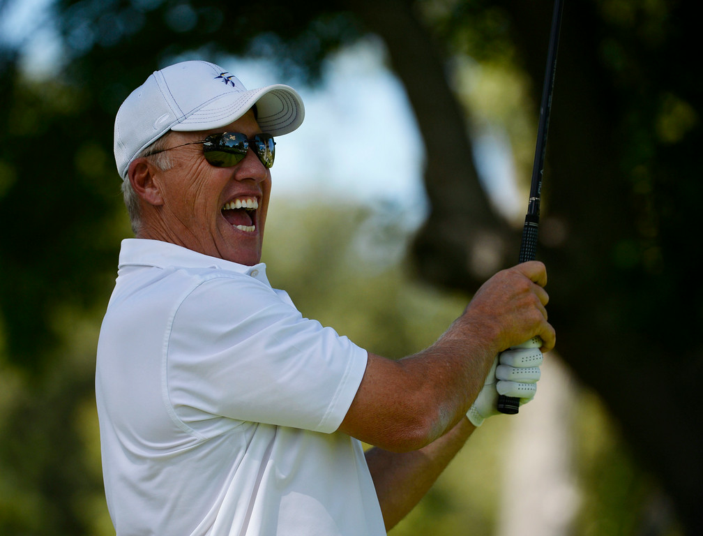 . CHERRY HILLS VILLAGE, CO. - SEPTEMBER 03:  John Elway reacts to his tee shot off the #2 tee box during the FedExCup BMW Championship Pro-Am at the Cherry Hills Country Club Wednesday afternoon, September 03, 2014. (Photo By Andy Cross / The Denver Post)
