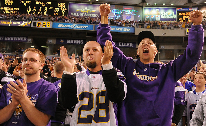 . Vikings fans celebrate the Vikings stopping Washington on the four-yard line with 28 second to go. (Pioneer Press: John Autey)