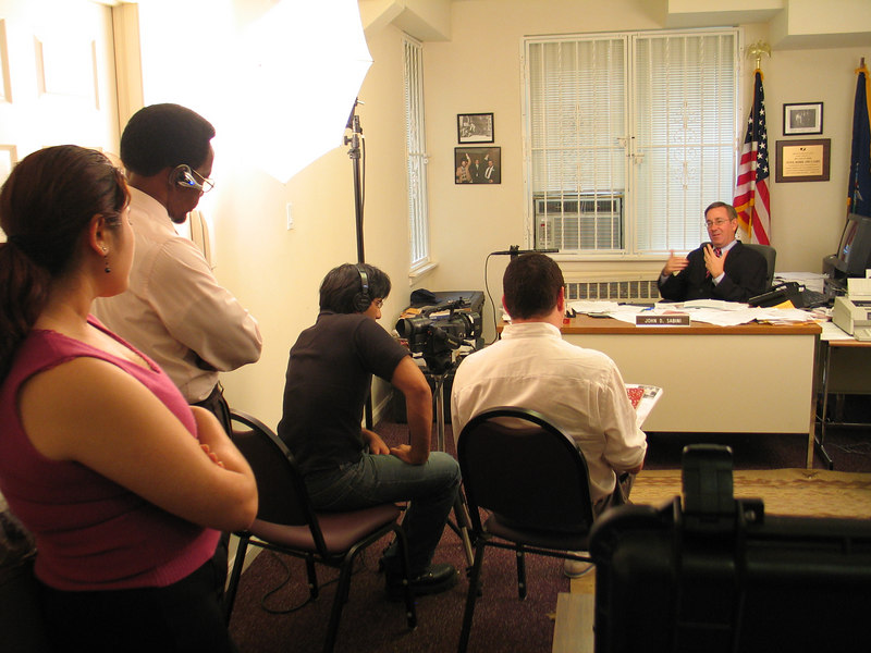 State Senator John D. Sabini, who has introduced a bill legalizing 'social poker' in restaurants, clubs and bars in New York, is interviewed for a documentary film on the country's poker craze.  Photo © Shams Tarek (shams.m.tarek@gmail.com)