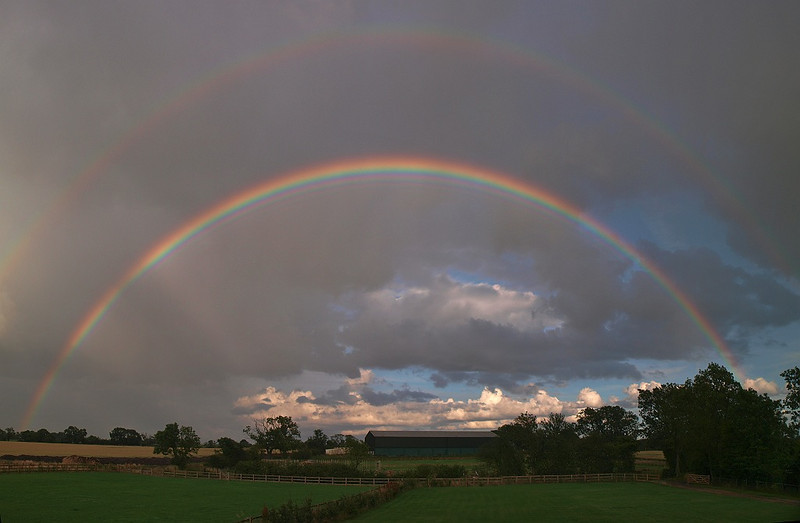 23 July 2009. Great day for home grown storms in Leics, UK. Some wonderful rainbow opportunities which I captured with my Olympus E3, 50-200mm SWD lens. Took this full view panorama, detailing primary and secondary  bows from bedroom window!