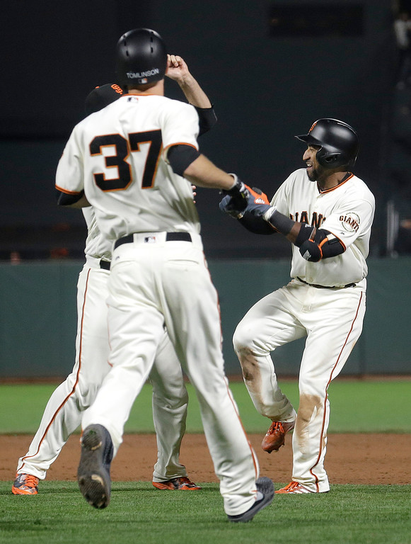 . San Francisco Giants\' Eduardo Nunez, right, celebrates with teammates after singling to score Kelby Tomlinson (37) for the winning run during the 10th inning against the Cleveland Indians in a baseball game in San Francisco, Tuesday, July 18, 2017. The Giants won 2-1. (AP Photo/Jeff Chiu)