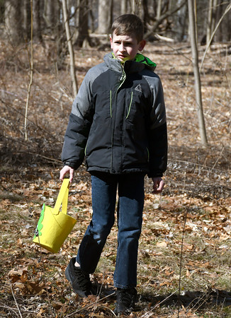 3/31/2018 Mike Orazzi | Staff William Chyra looks for Easter eggs during the Easter Eggstravanganza at the Hungerford Park Nature Center in Kensington Saturday.
