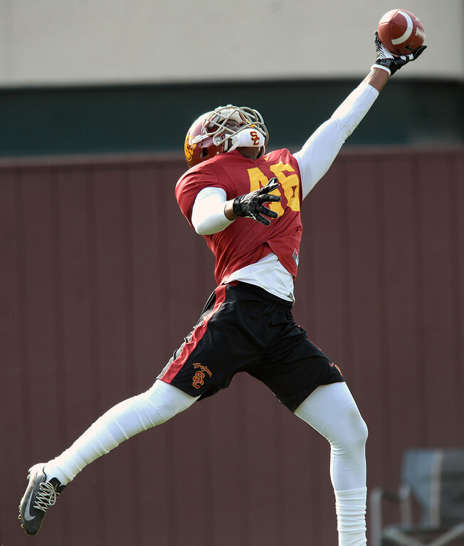 . USC WR Aaron Minor stretches for a pass during practice, Tuesday, March 25, 2014, at USC. (Photo by Michael Owen Baker/L.A. Daily News)
