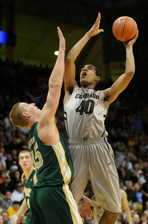 . Buffs forward Josh Scott (40) put a shot over Rams center Colton Iverson (45) in the first half. The University of Colorado men\'s basketball team hosted Colorado State University inside the Coors Events Center Wednesday night, November 5, 2012. Karl Gehring/The Denver Post