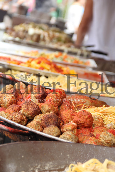 Various pastas for sale at a pasta bar during the Butler Italian Festival are shown. Each plate contains about 20 to 30 pounds of pasta. 2018  Lauryn Halahurich/Butler Eagle