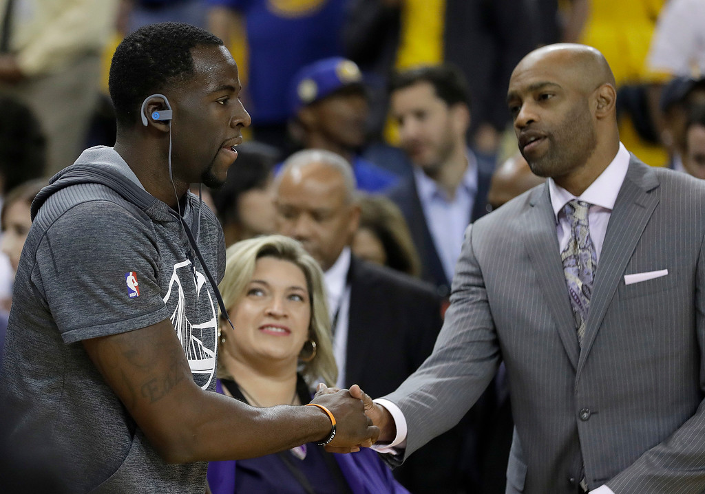 . Golden State Warriors forward Draymond Green, left, shakes hands with Vince Carter before Game 5 of basketball\'s NBA Finals between the Warriors and the Cleveland Cavaliers in Oakland, Calif., Monday, June 12, 2017. (AP Photo/Marcio Jose Sanchez)