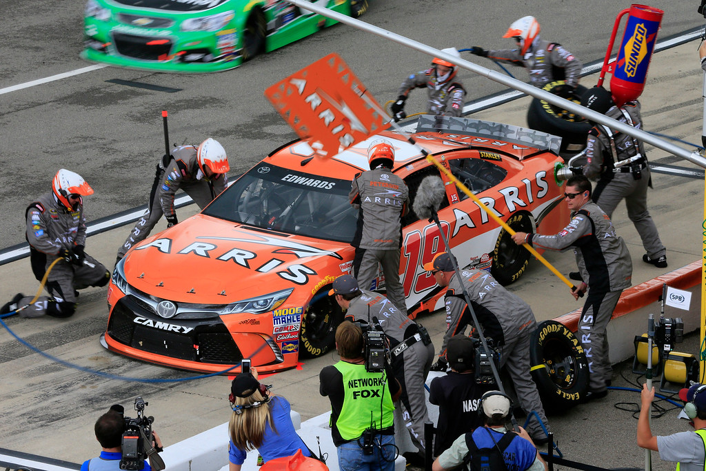 . Carl Edwards makes a pit stop during the NASCAR Sprint Cup series auto race at Michigan International Speedway, Sunday, June 14, 2015, in Brooklyn, Mich. (AP Photo/Carlos Osorio)