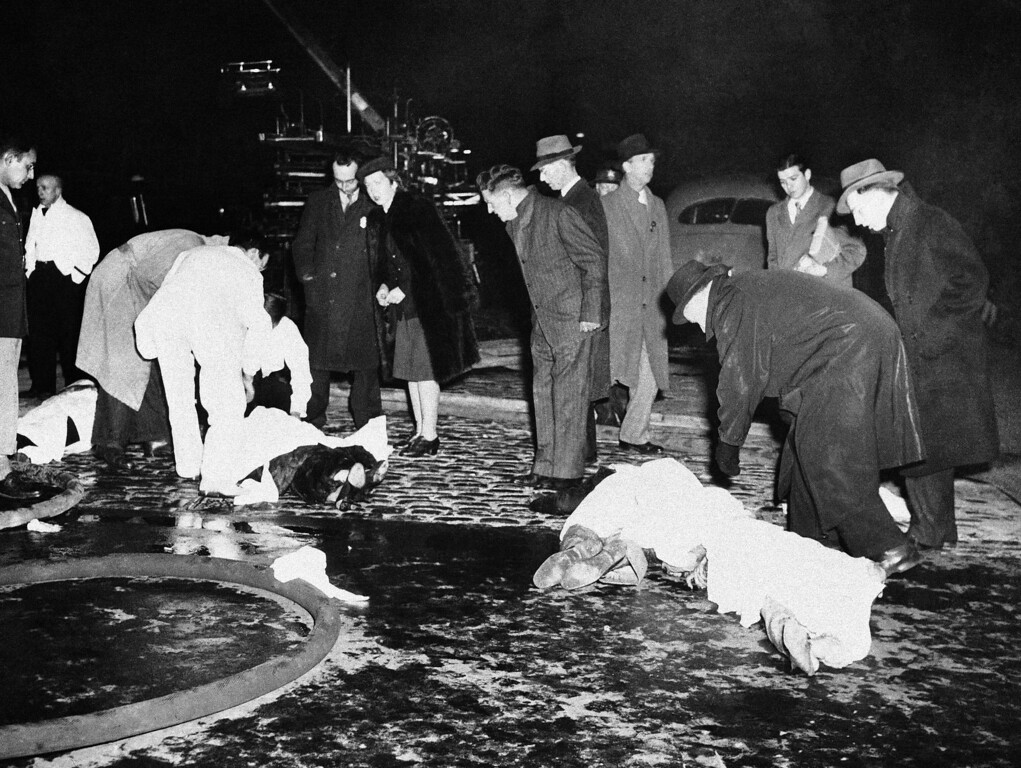 . Victims of the fire in Cocoanut Grove Night Club, lie stretched out on a Boston street, Nov. 28, 1942, while spectators and friends hunt for relatives, and ambulance crews check for signs of life. (AP Photo)