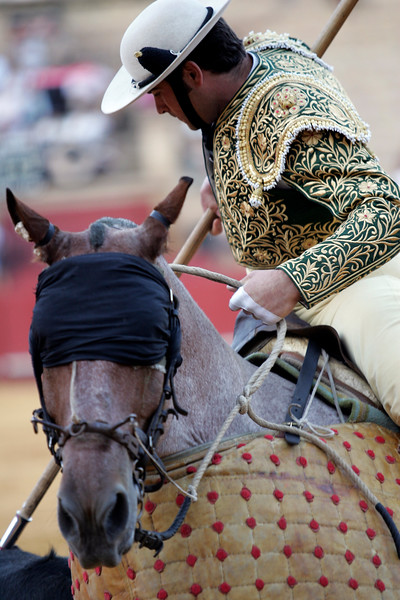 Picador in action with his blinded horse. Bullfight at Real Maestranza bullring, Seville, Spain, 15 August 2006.