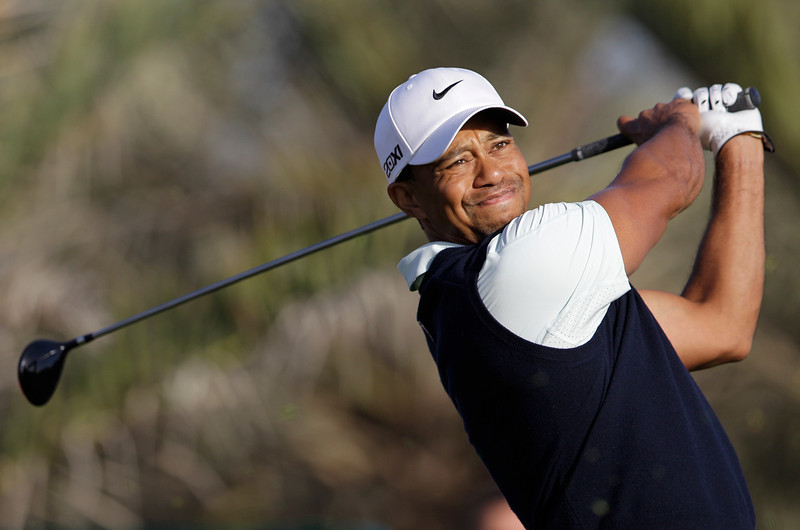 . Tiger Woods from U.S. tees off on the 14th hole during the first round of Abu Dhabi Golf Championship in Abu Dhabi, United Arab Emirates, Thursday, Jan. 17, 2012. (AP Photo/Kamran Jebreili)