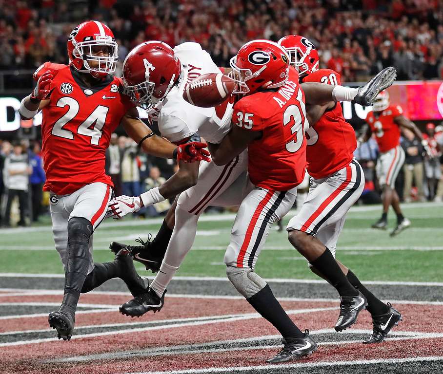. Georgia\'s Dominick Sanders breaks up a pass intended for Alabama\'s Jerry Jeudy during the second half of the NCAA college football playoff championship game Monday, Jan. 8, 2018, in Atlanta. (AP Photo/David Goldman)