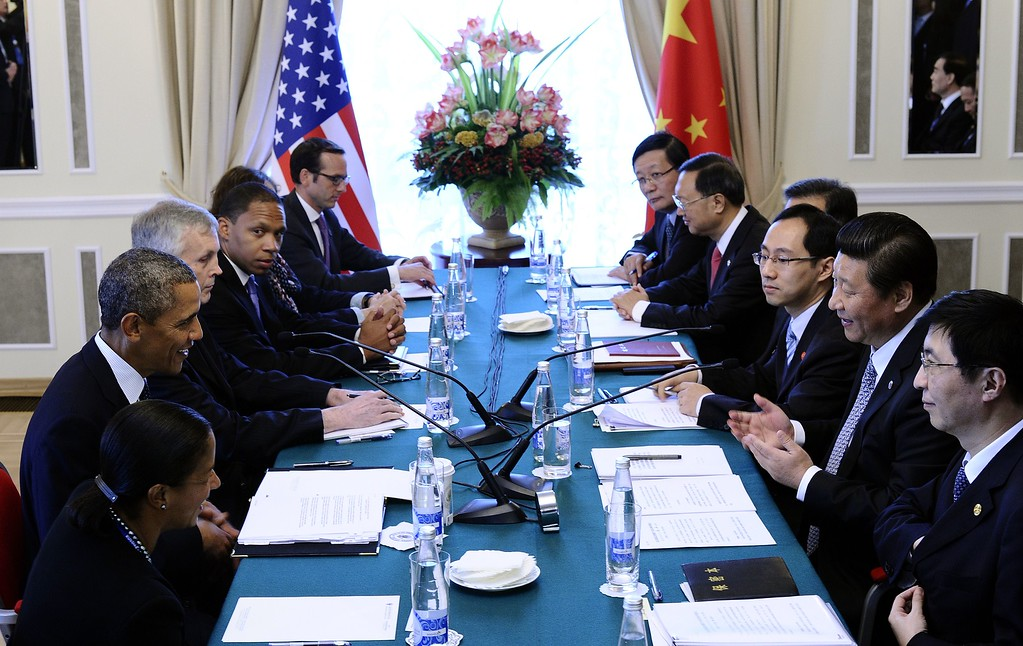 . US President Barack Obama (2L) speaks during a bilateral meeting with Chinese President Xi Jinping (2R) in Saint Petersburg on September 6, 2013 on the sideline of the G20 summit. World leaders met at the G20 summit in Russia as tensions over the Syrian conflict threatened to torpedo the work plan of the summit. Pleas for Washington to step back from a war path grew louder, with China, the United Nations and even the pope chiming in. JEWEL SAMAD/AFP/Getty Images