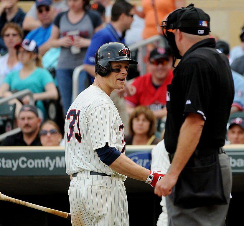 . Minnesota\'s Justin Morneau has a discussion with umpire Ron Kulpa after being rung up during the fifth inning. (Pioneer Press: John Autey)