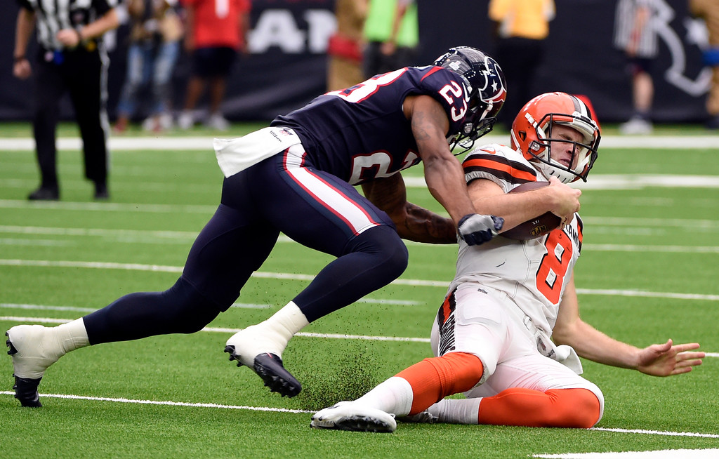 . Houston Texans safety Kurtis Drummond (23) stops Cleveland Browns quarterback Kevin Hogan (8) from advancing the ball on a run in the second half of an NFL football game, Sunday, Oct. 15, 2017, in Houston. (AP Photo/Eric Christian Smith)